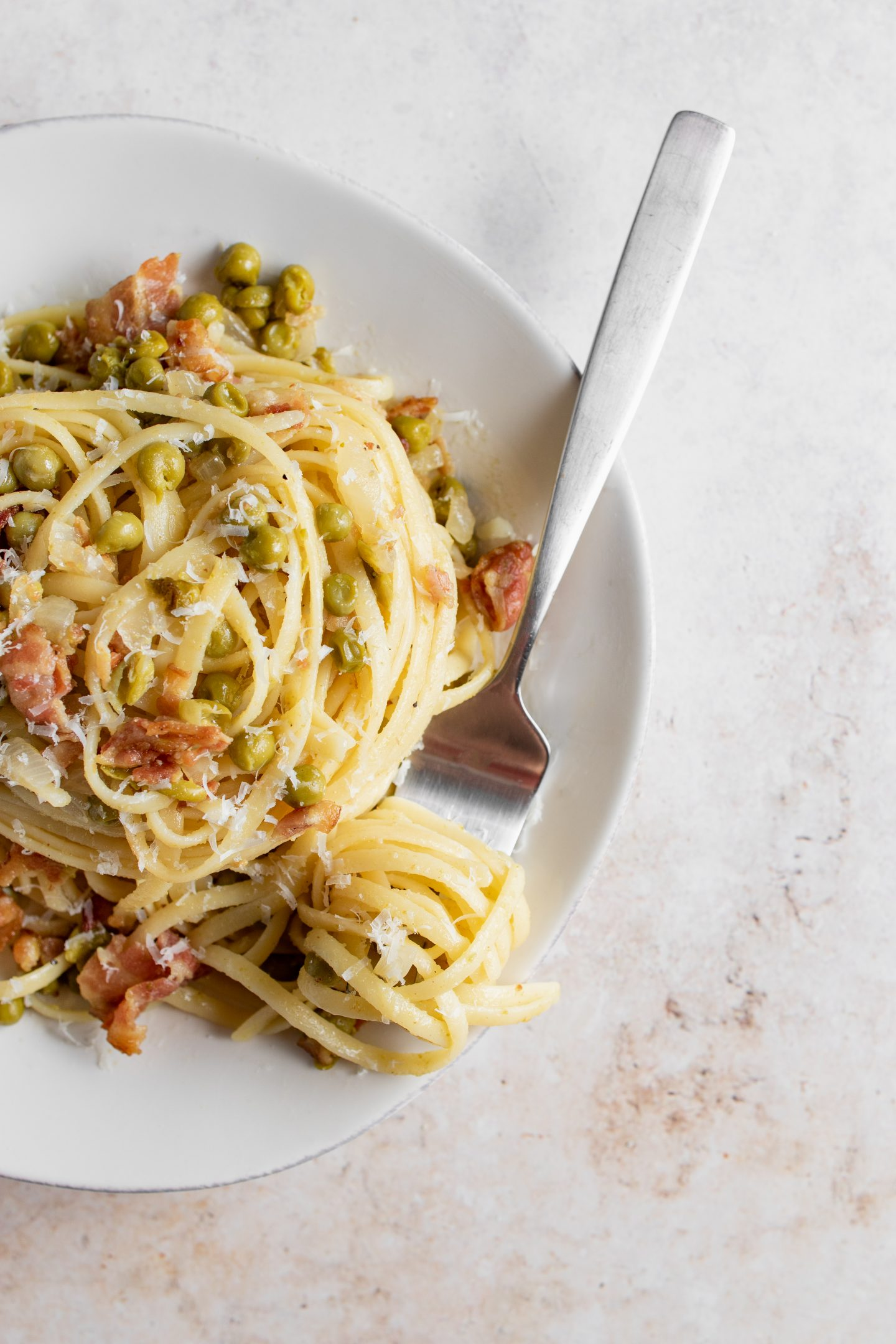 plate of pasta peas and bacon