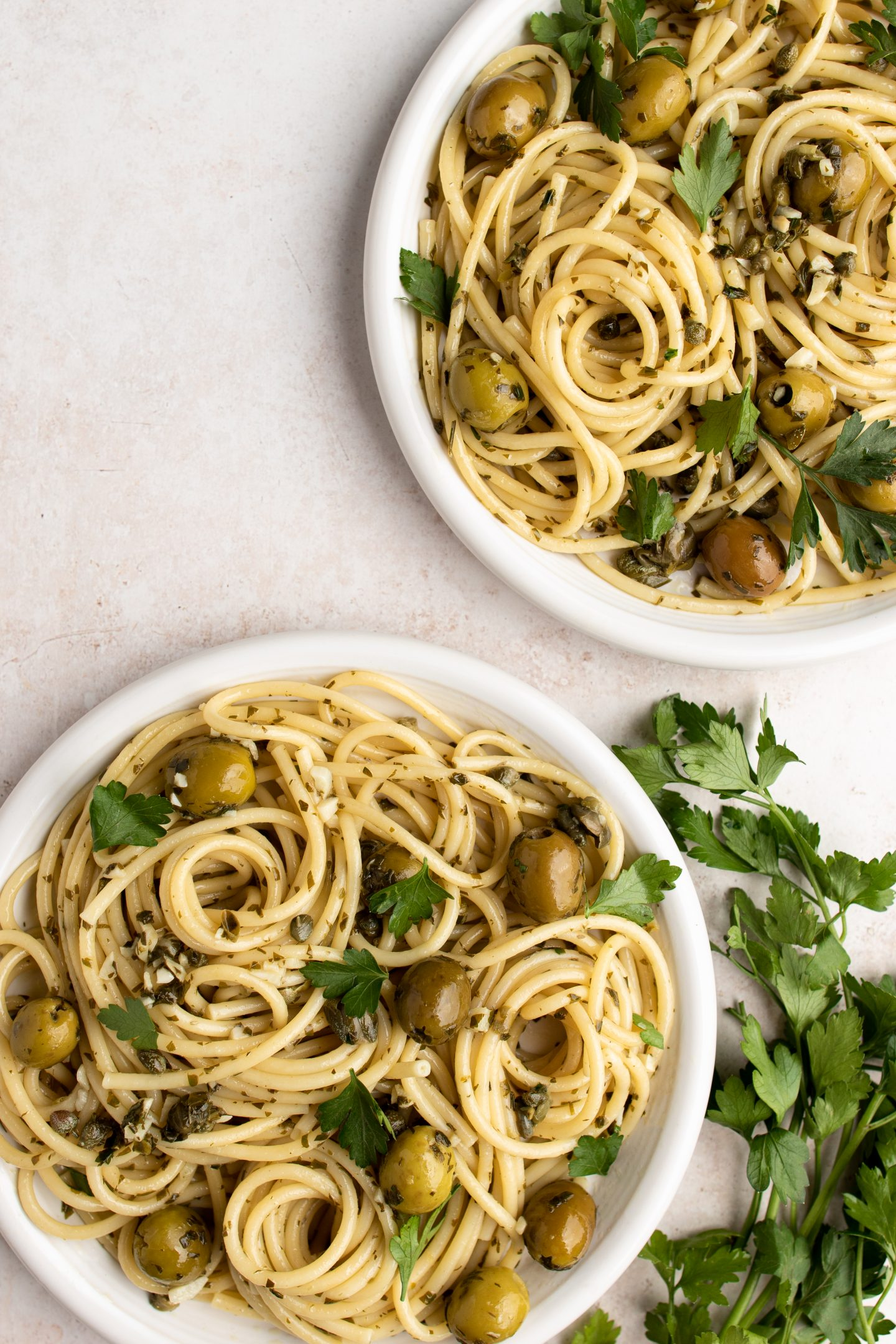 plates of green olive pasta